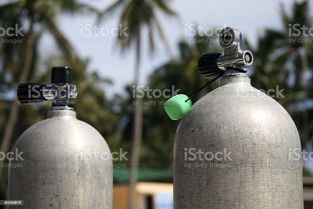 scuba tanks on the beach stock photo