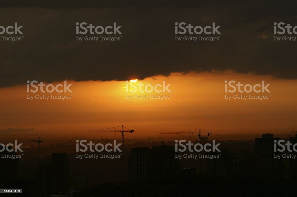 scudding cloud over the city stock photo