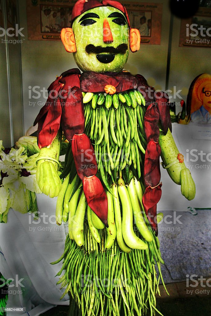 Sculpted Man in Vegetables stock photo
