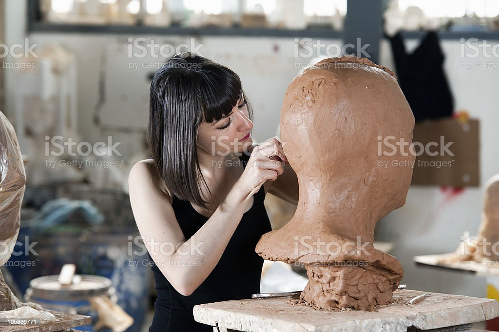 Sculptor at work stock photo
