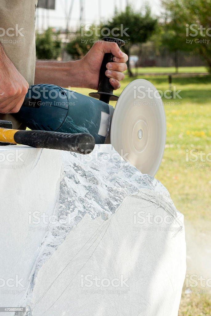 Sculptor with grinder machine stock photo