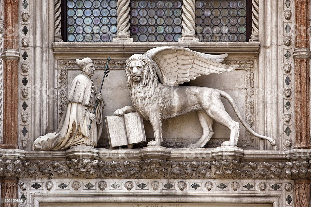 sculpture above Porta della Carta at the Doges palace stock photo
