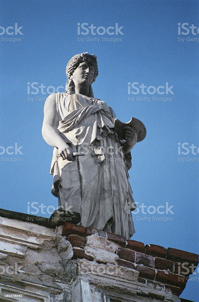 Sculpture above the cornice of  building . royalty-free stock photo