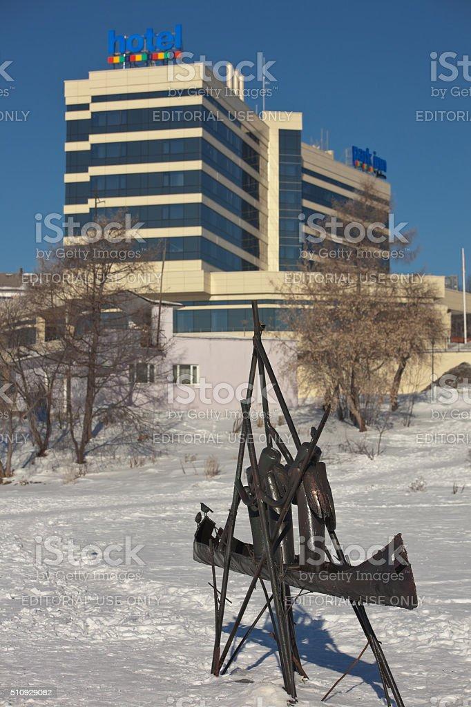 Sculpture and the hotel 'Park Inn by Radisson'. Nizhny Tagil. stock photo