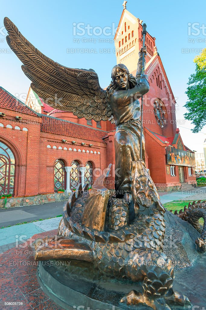Sculpture 'Archangel Michael spearing a dragon' at the Church of stock photo