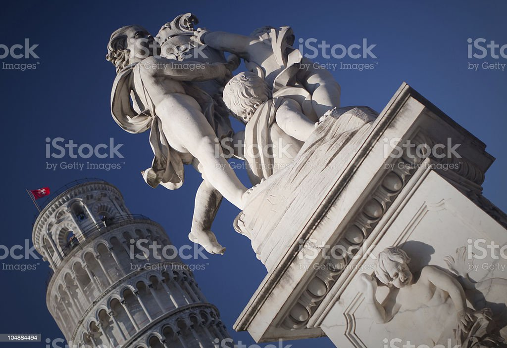 Sculpture in front of Pisa tower royalty-free stock photo