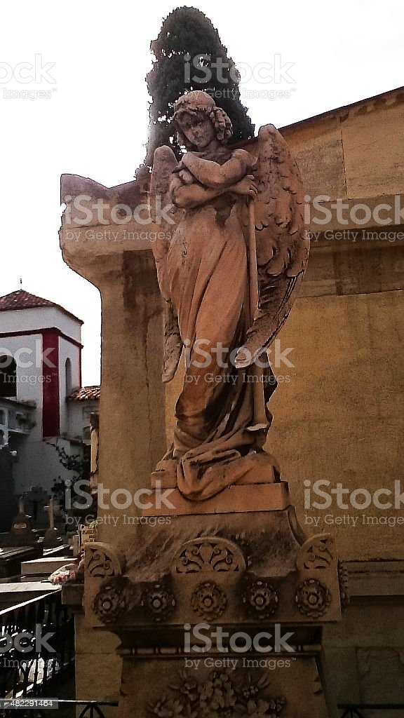 Sculpture of a guardian angel on a  cemetery grave stock photo