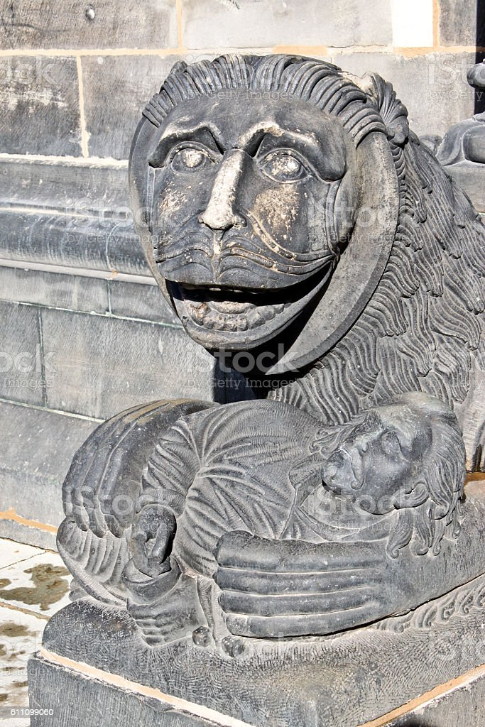 Sculpture of a lion near entrance of Bremen Cathedral stock photo
