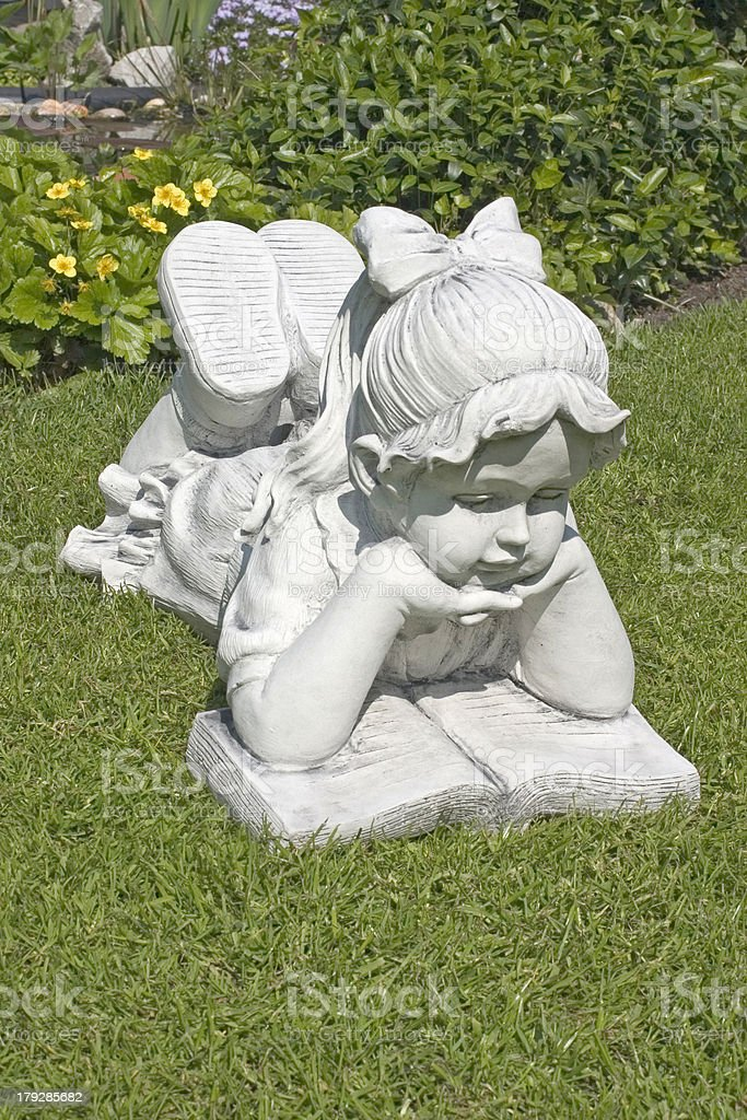 Sculpture of a reading girl royalty-free stock photo