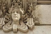 Sculpture of a woman´s head decorates a facade