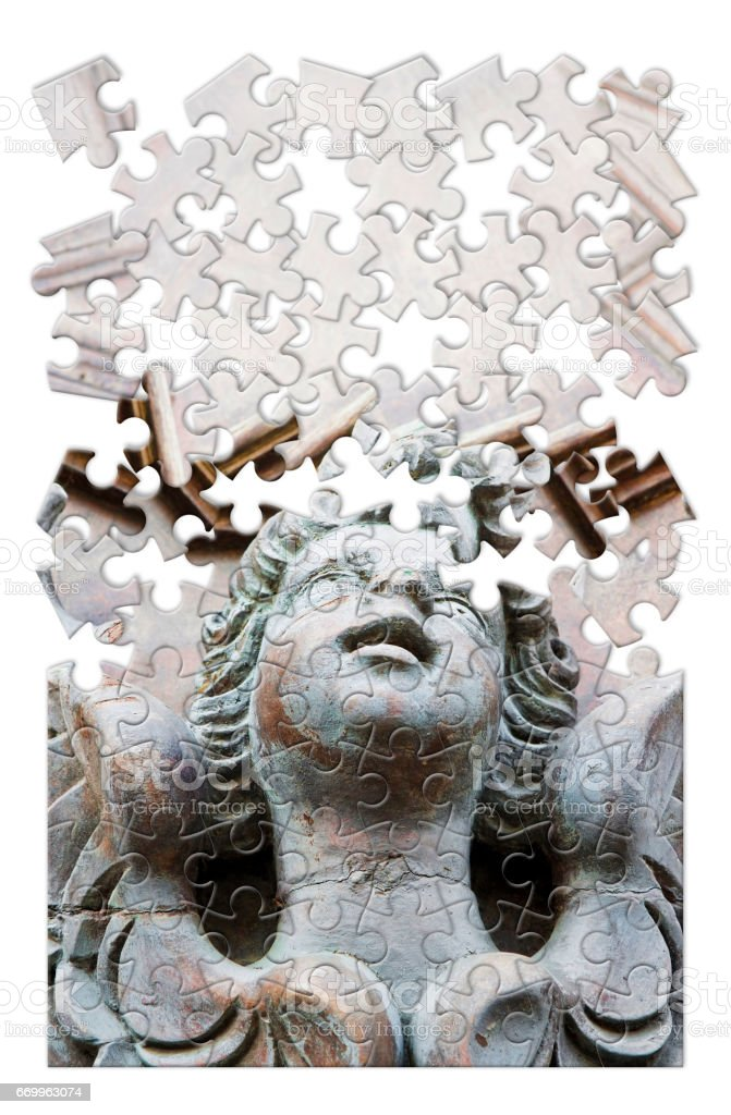Sculpture of an angel on a wooden door - concept image in puzzle shape stock photo