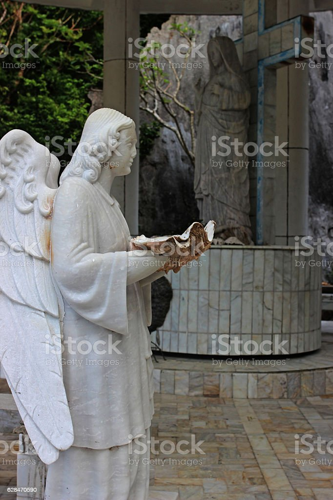 Sculpture of an angel with a sea shell . Philippines stock photo