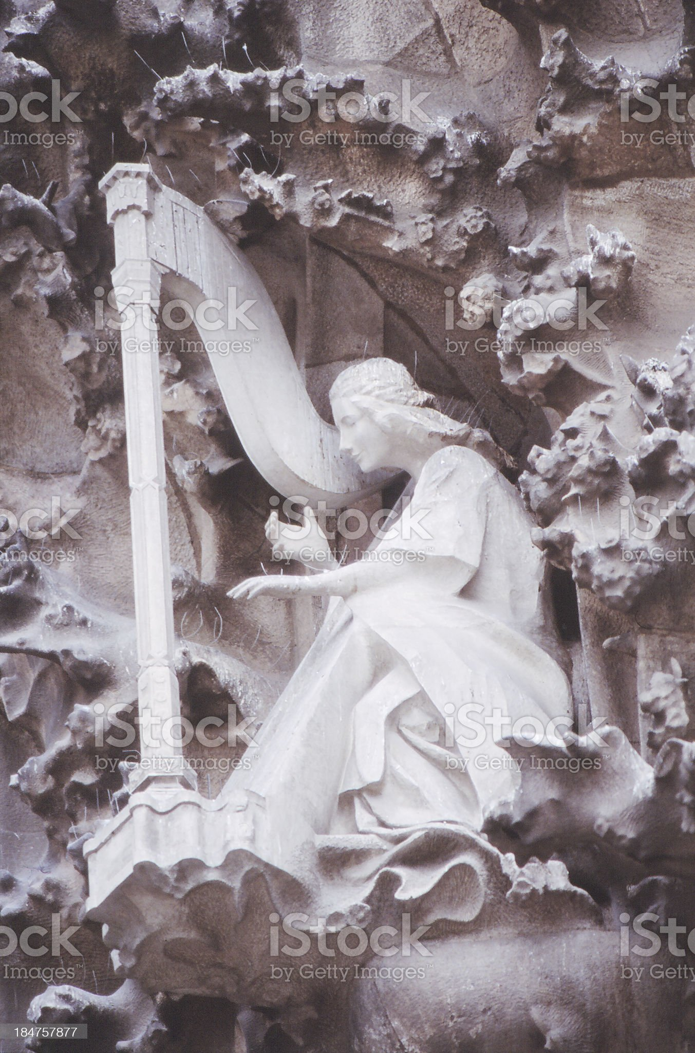 Sculpture of angel playing harp royalty-free stock photo