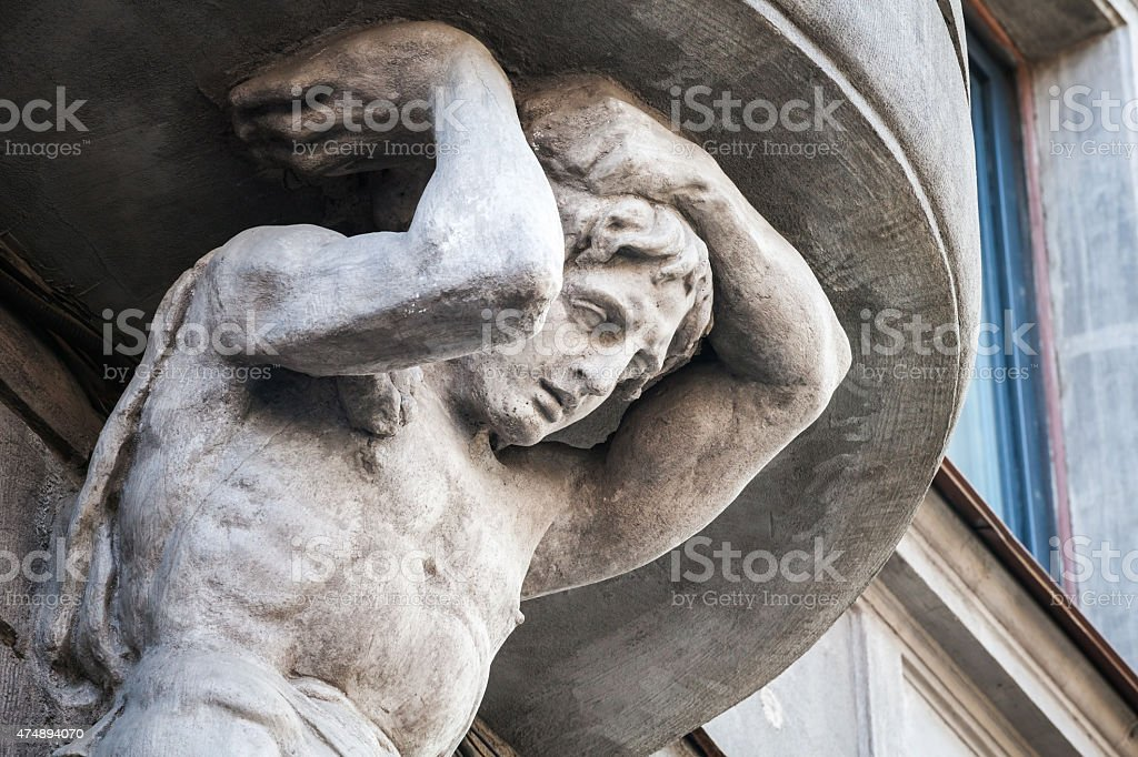 Sculpture of Atlant on facade of the old building stock photo