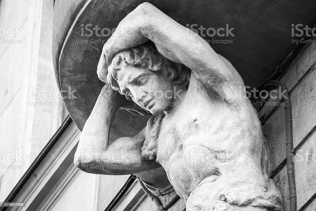 Sculpture of Atlant on the facade of old house stock photo
