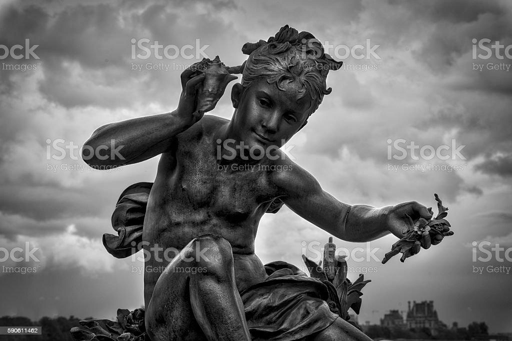 Sculpture of Child on the bridge of Alexander III stock photo