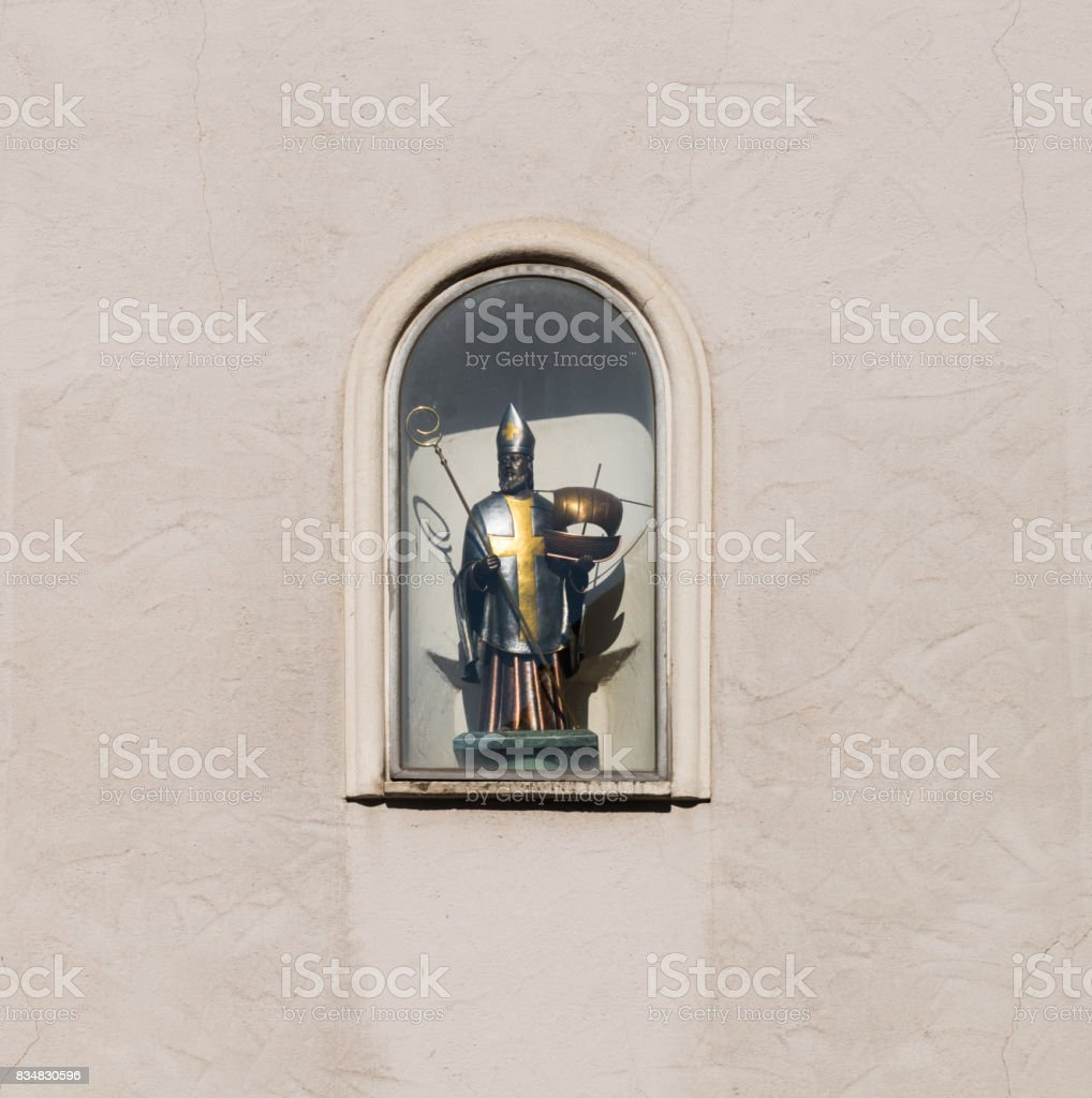 Sculpture of holy St Nicholas on a house wall in Regensburg, Germany stock photo