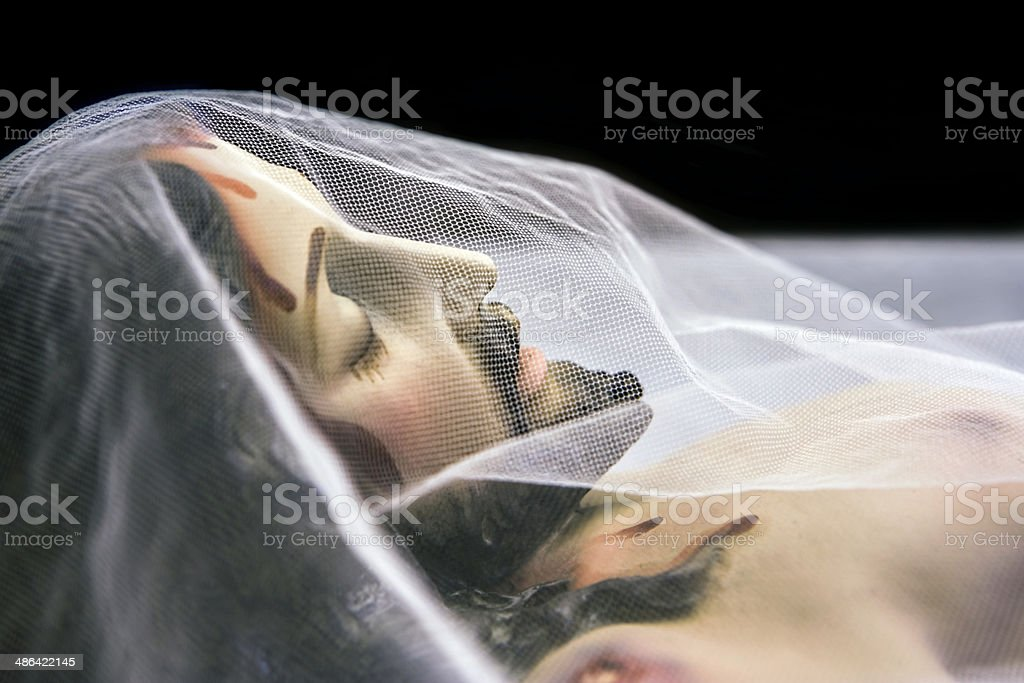 Sculpture of reclining Jesus in the holy tomb stock photo