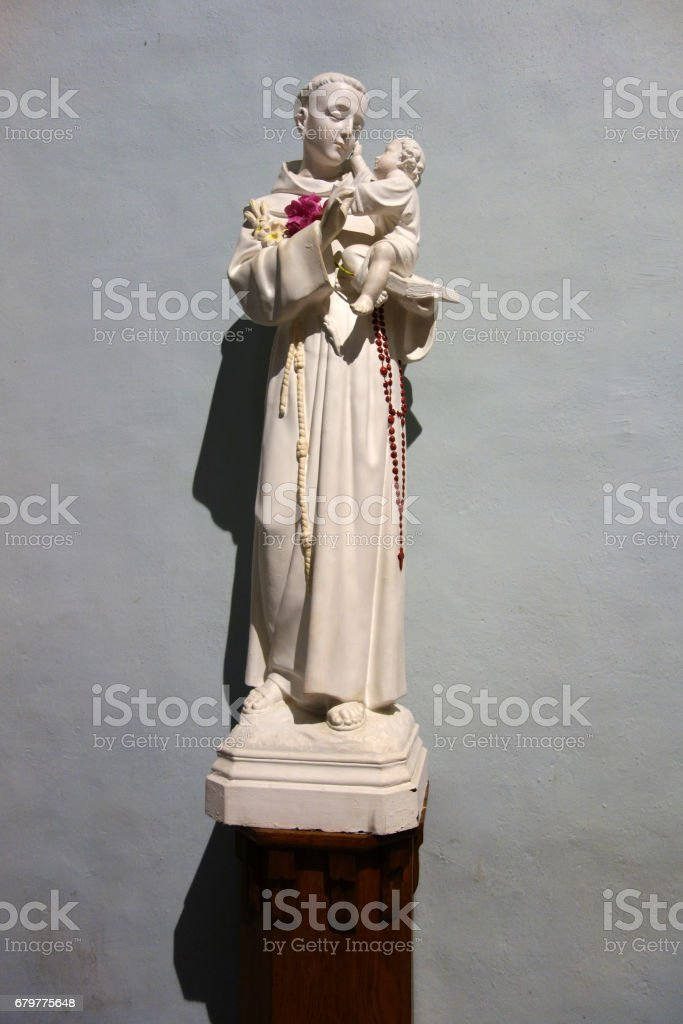 Sculpture of Saint Anthony in Saint Pierre, Laruns, France stock photo