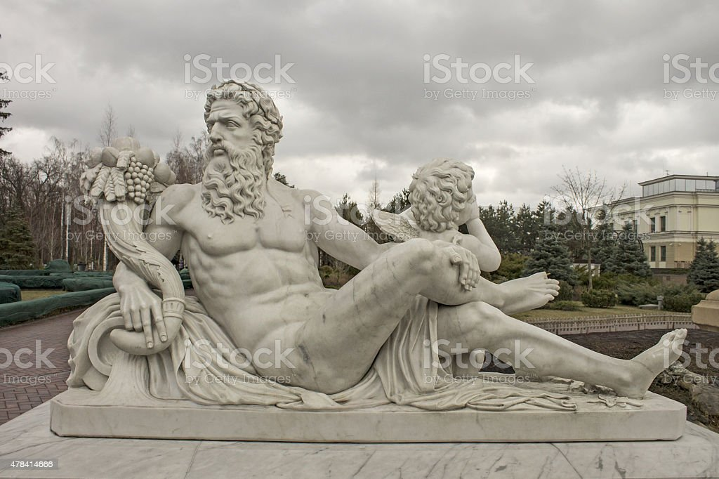 Sculpture of the god Zeus and Cupid stock photo