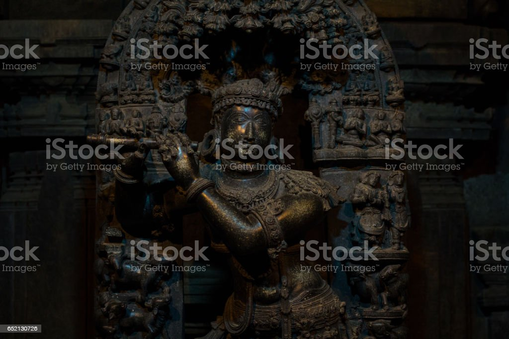 Sculpture of the Hindu god Vishnu playing a flute at Chennakesava Temple,Somanathapura,Karnataka, India, Asia stock photo
