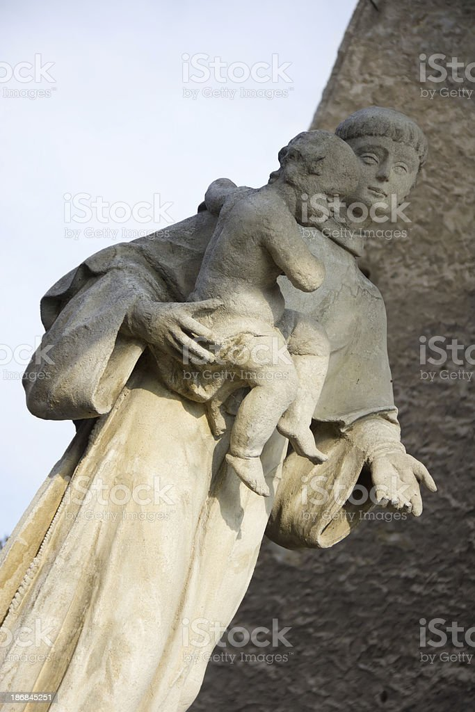 sculpture of the saint with a child royalty-free stock photo