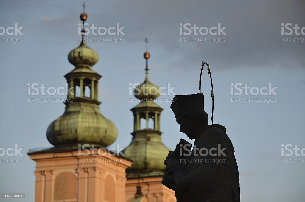 Sculpture priest with Bible in sunshine stock photo