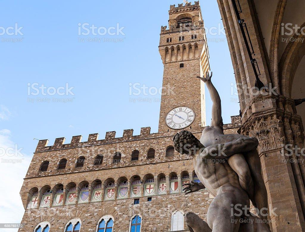 sculpture Rape of Sabine Women and Palazzo Vecchio stock photo