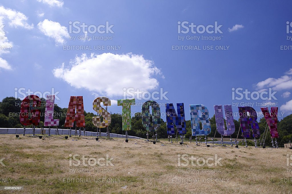 Sculpture Wording on the hill overlooking Glastonbury Festival. stock photo