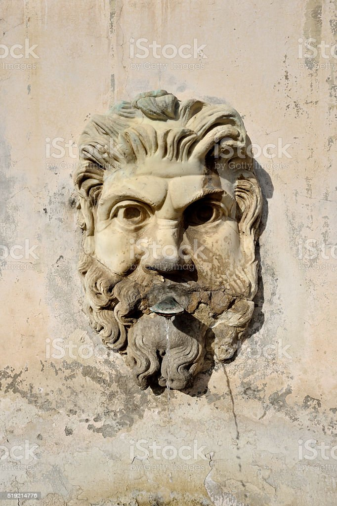 Sculptured Head and Fountain stock photo