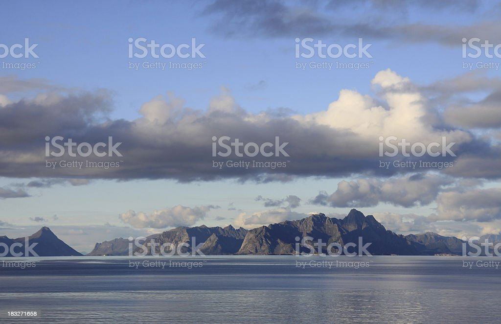 sea alps and clouds, scenery panorama coastal landscape norway stock photo