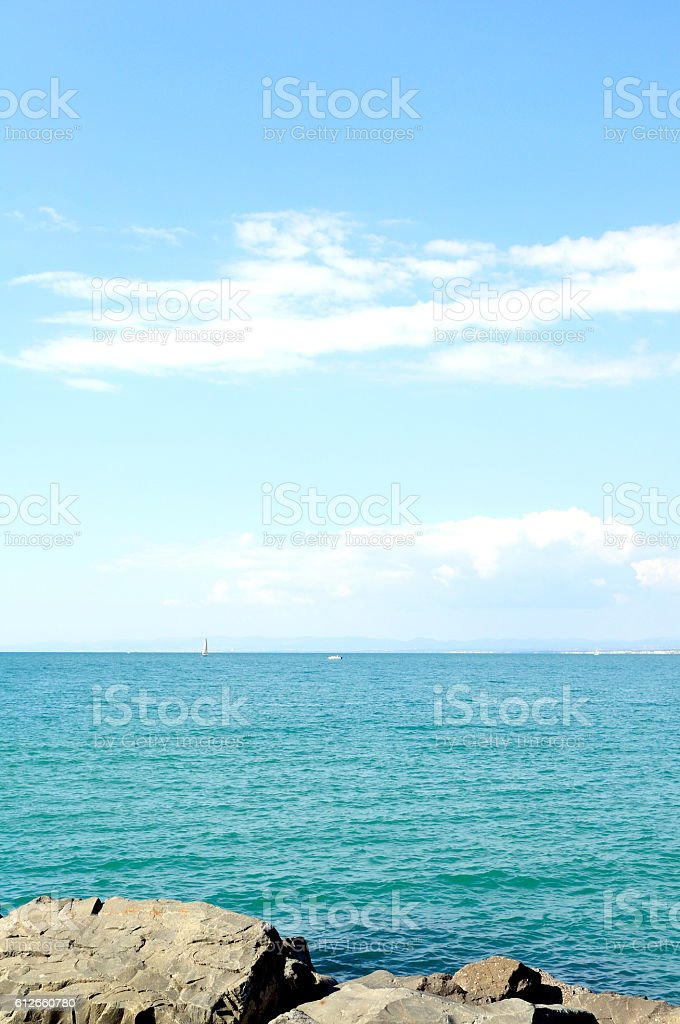 Sea and blue sky, vertical stock photo