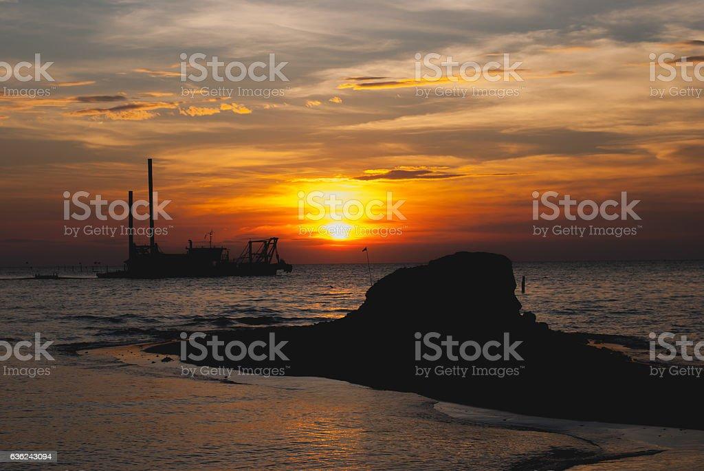 Sea and boats at sunset stock photo