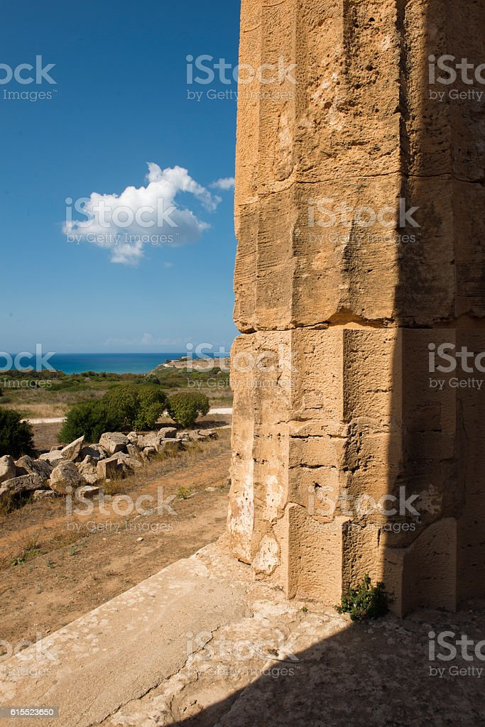sea and Greek column in Selinunte Sicily Italy stock photo