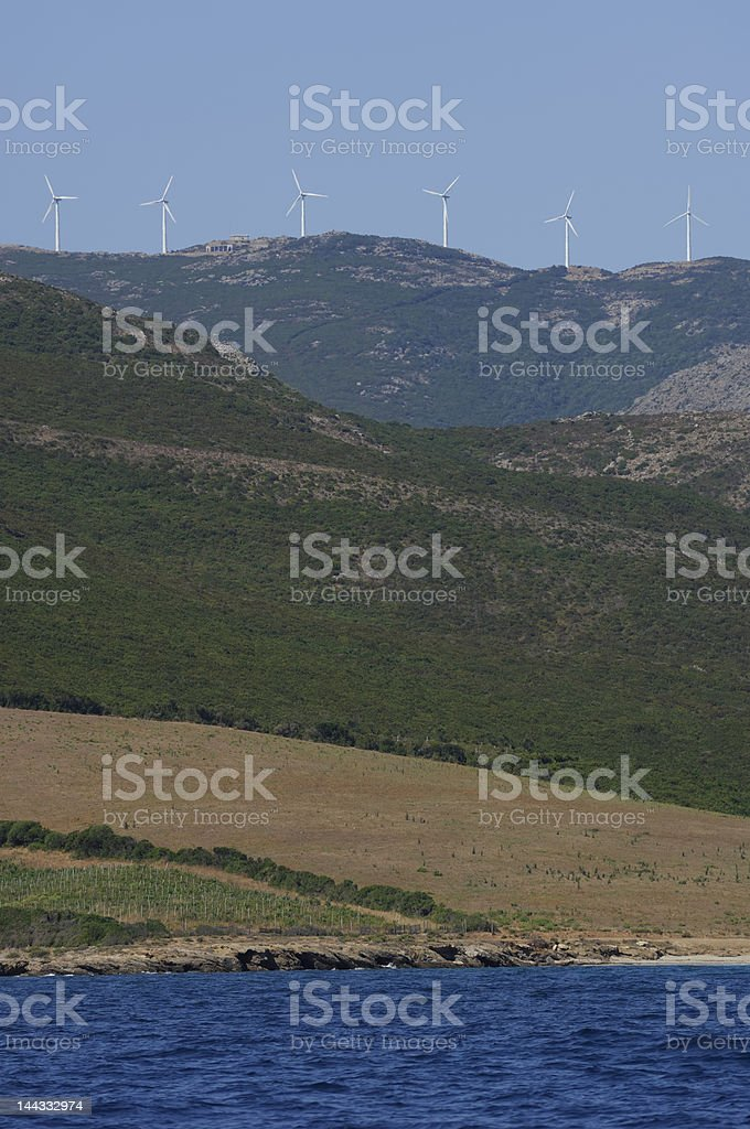 sea and hill with windmill royalty-free stock photo