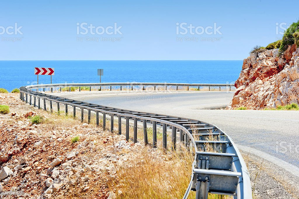 Sea and mountain highway fenced striker royalty-free stock photo