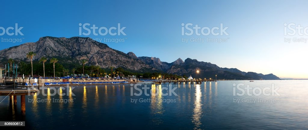 Sea and mountains in evening stock photo