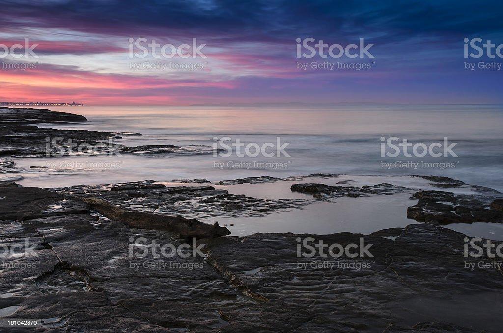 Sea and rocks at sunset, Apulia, Italy royalty-free stock photo
