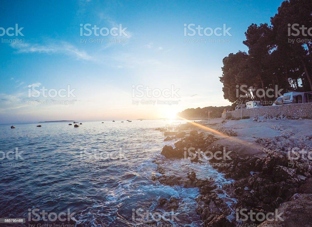 Sea and sunset stock photo