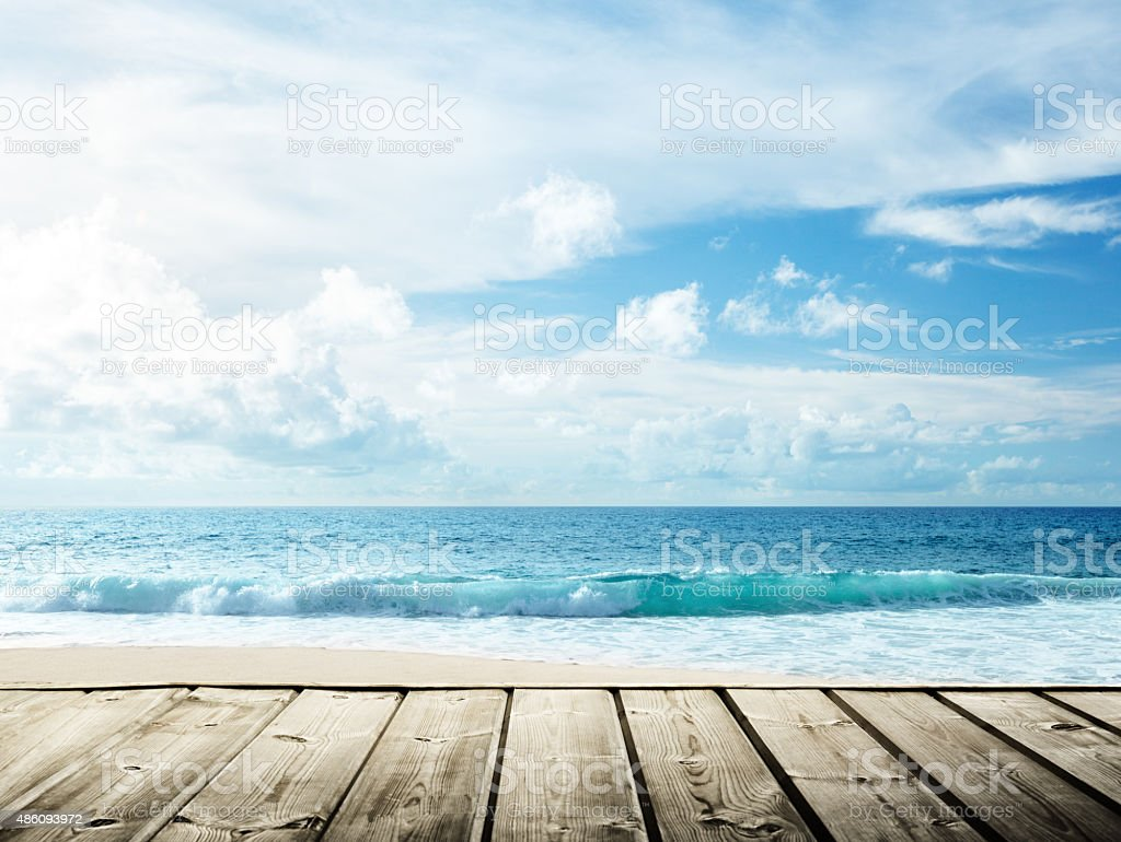 sea and wooden platform stock photo