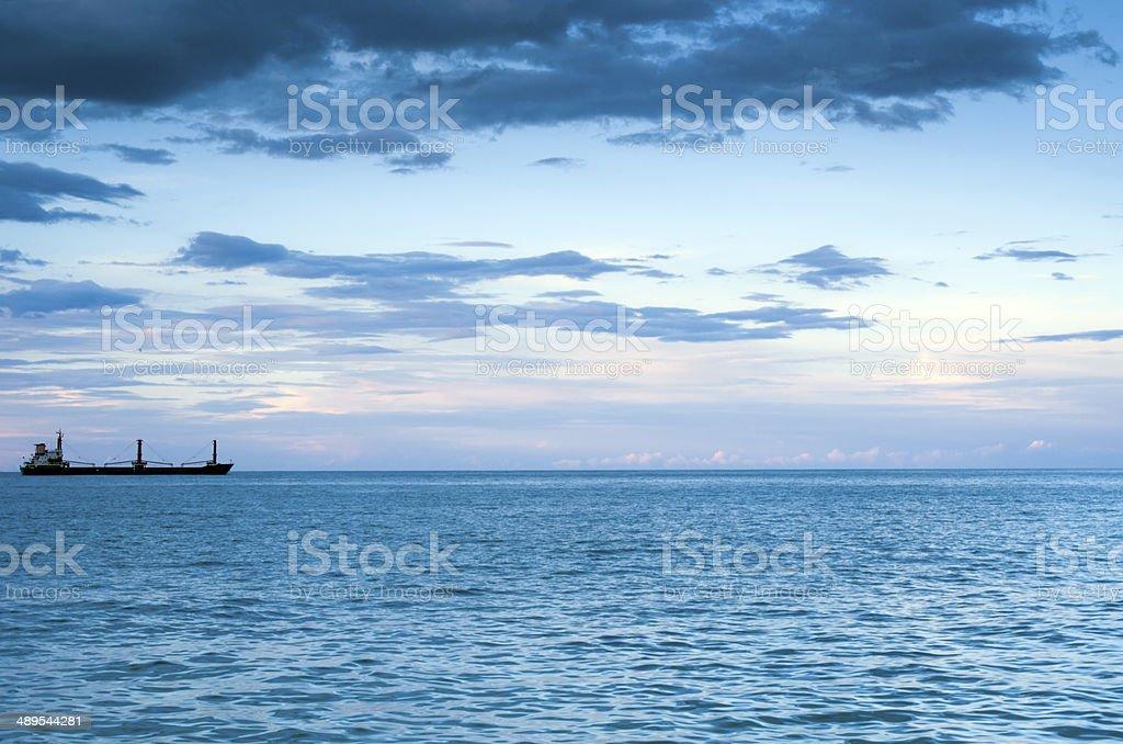 Sea at sunrise in Gursuf with boat stock photo