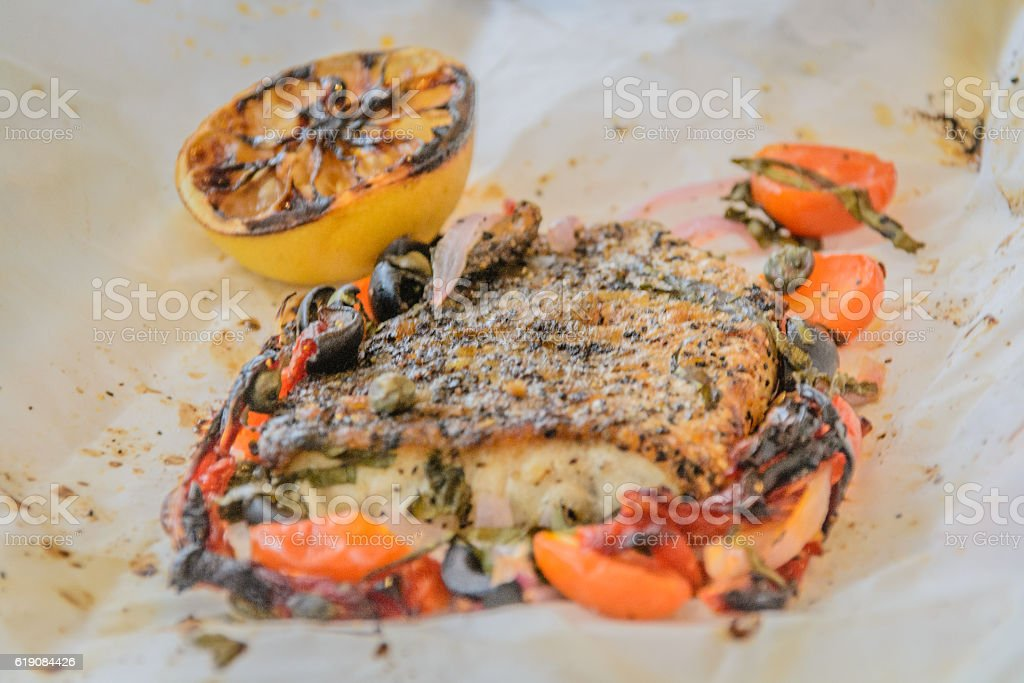 Sea bass Al Cartoccio fresh sea bass fillet stock photo