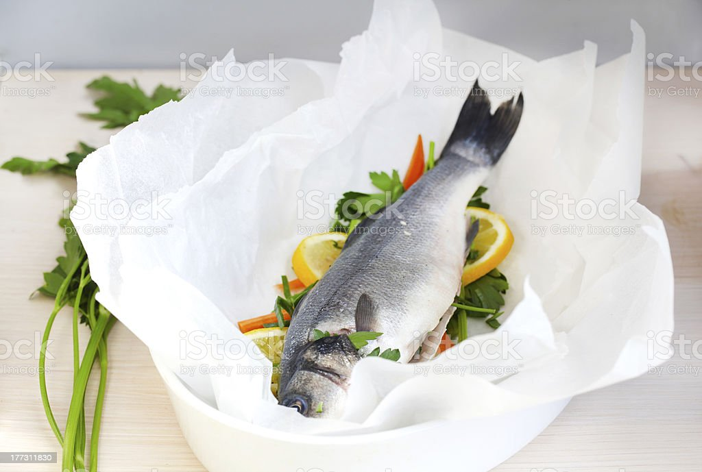 Sea bass en papillote with vegetables stock photo