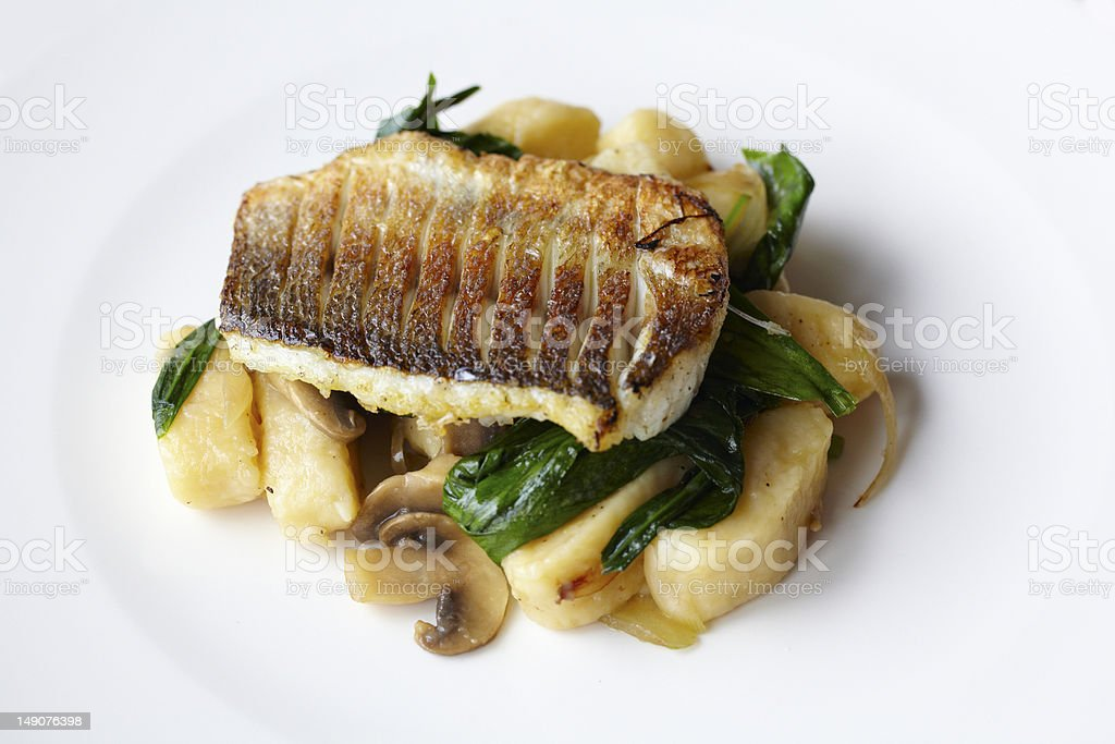 Sea bass filet on potato gnocchi royalty-free stock photo