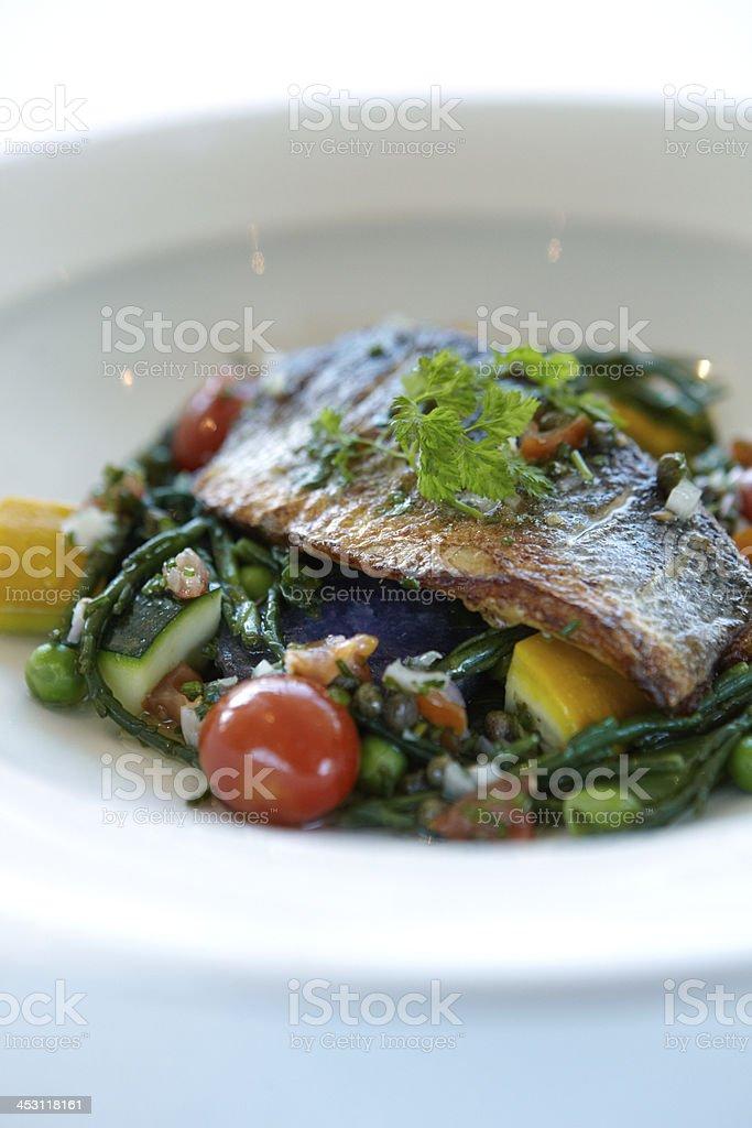 Sea bass fillet salad royalty-free stock photo