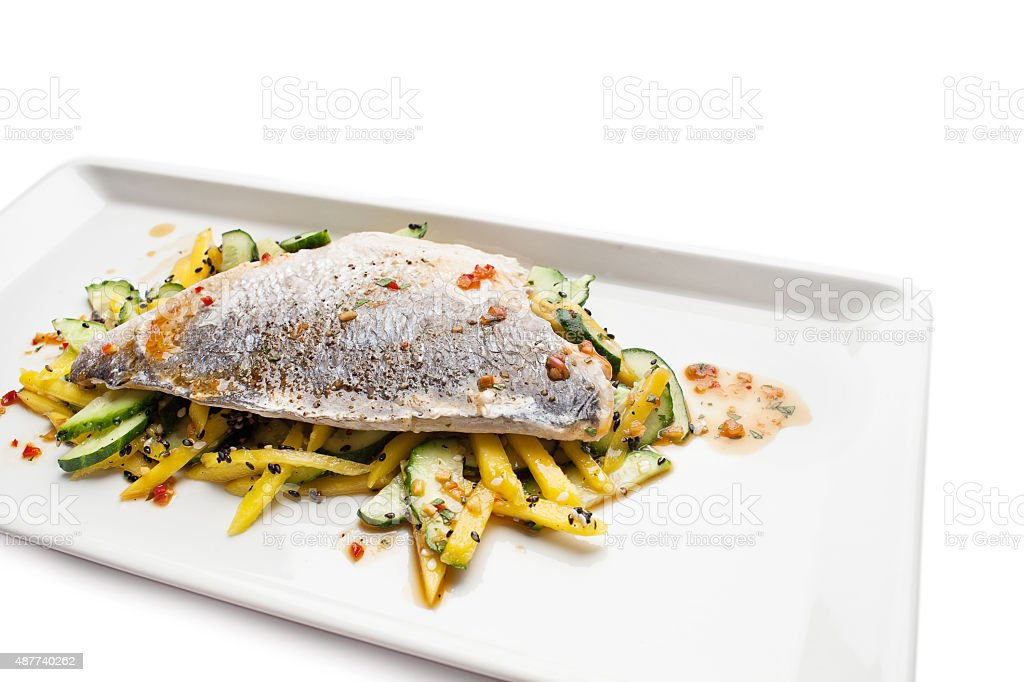 Sea bass fillet served on a white plate stock photo