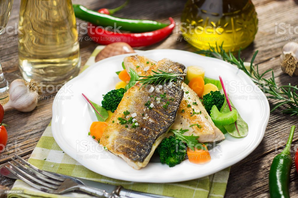 Sea bass fillet with vegetables stock photo