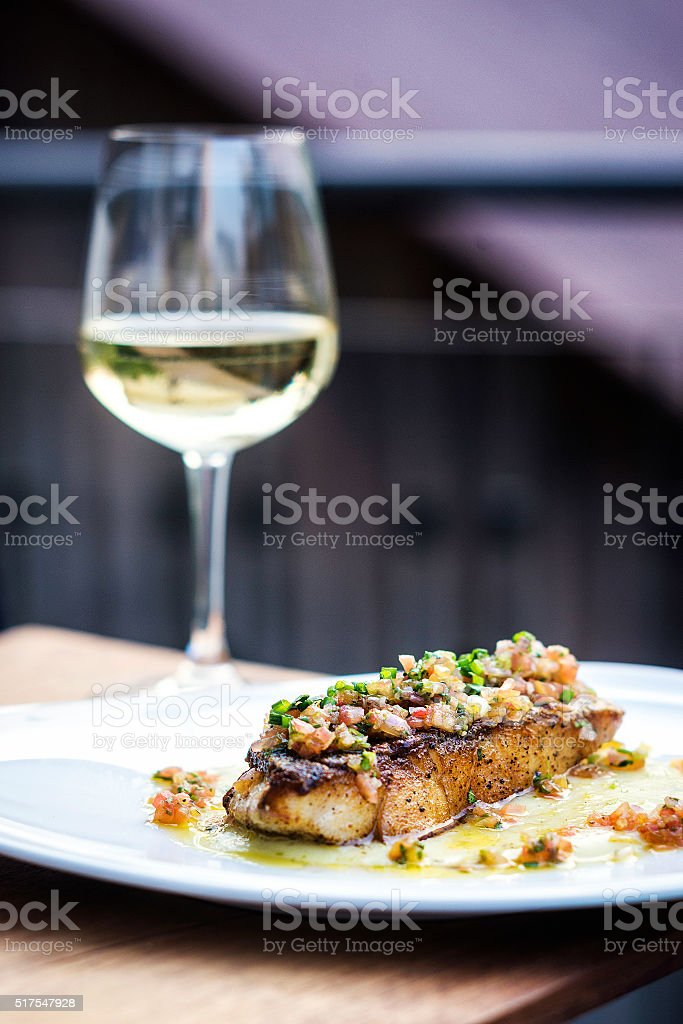 sea bass fish with mexican salsa sauce stock photo