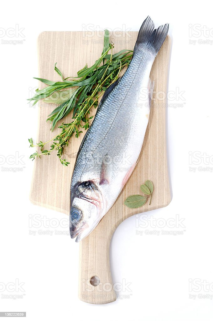 Sea bass with herbs royalty-free stock photo