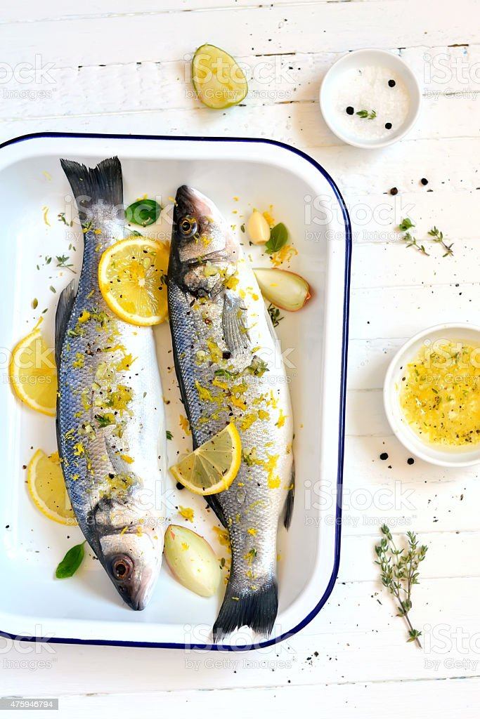 sea bass with lemon and thyme stock photo